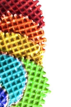 Fresh crisp color waffles isolated on white background photo