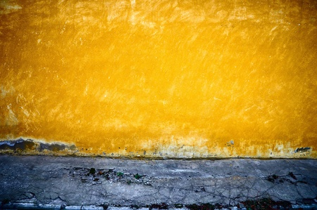stucco: It is yellow - a dark blue background in style grunge.