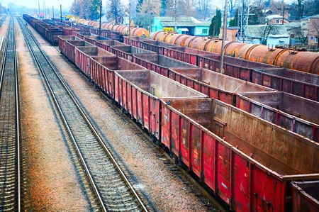 railroad track: Empty railway containers for transportation covered with a rust