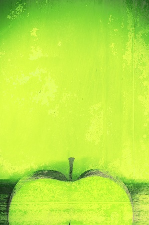 Art texture. An abstract background, a green apple in style grunge