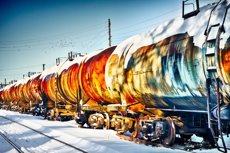 Set of old tanks with oil and fuel transport by rail in winter photo