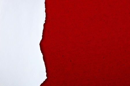 Rip white paper on red cardboard background photo