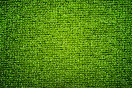 Background a texture a knitted woolen fabric of dark green color photo