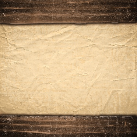 The old texture of a paper, is decorated in grunge style. Background in style vintage photo