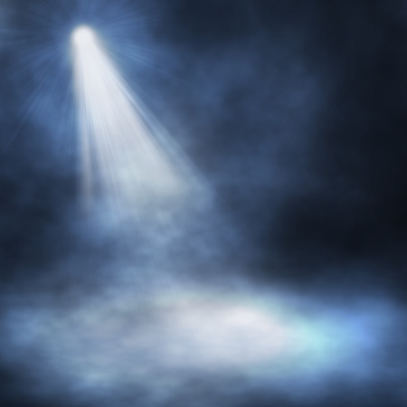 Spotlight single blue on smog background photo
