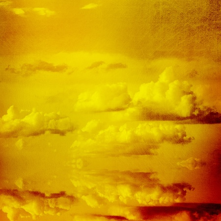 Grunge paper texture.  Gold sky background. photo