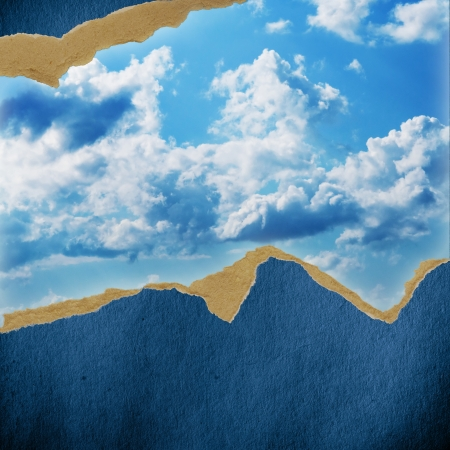 riped vintage paper on sky cloud background photo
