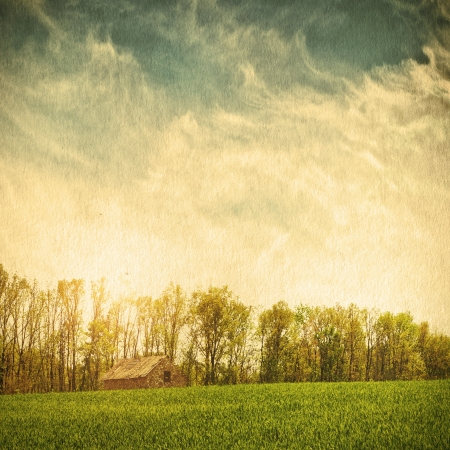 Sky field landscape on a textured vintage paper background photo