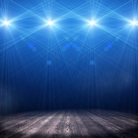 Antecedentes en el interior espect?culo brill? con un proyector Foto de archivo - 21372540