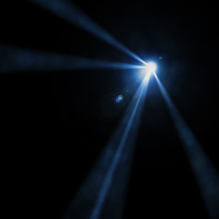 flashlight: Background in show. Light of a searchlight beams through a smoke.