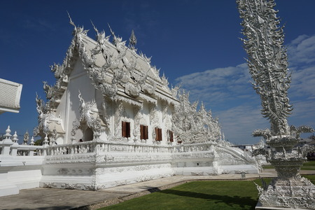 Wat Rong Khun, better known to foreigners as the White Temple, is a Buddhist temple in Chiang Rai, Thailand. Stock Photo