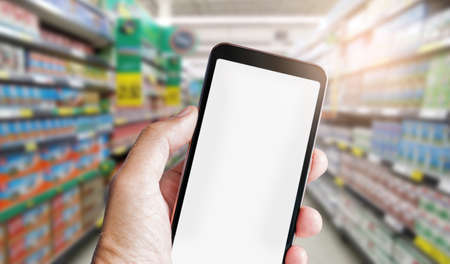 Human hand holding mobile phone and using mobile app order online from supermarket, Concept shopping online for recive discount Banque d'images