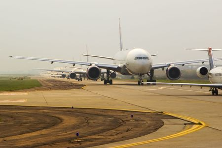Commercial airplanes in line to take off