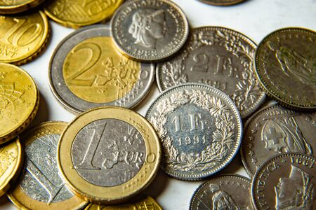 Euro and Swiss Franc coins