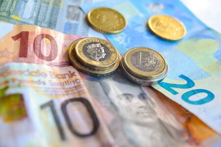 Euro and Pound coins and banknotes Archivio Fotografico