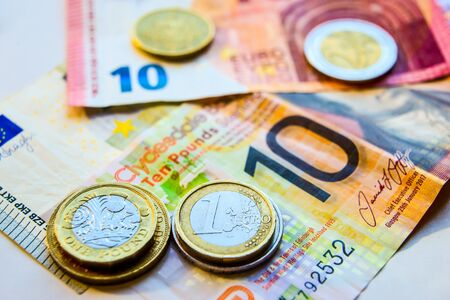 Euro and Pound coins and banknotes