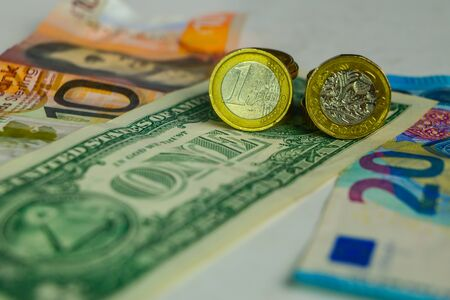 Dollar, Euro and Pound coins and banknotes