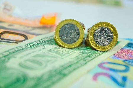Dollar, Euro and Pound coins and banknotes Archivio Fotografico