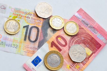 Pound and Euro coins and banknotes