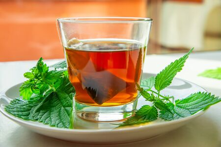 Nettle infusion in a transparent cup
