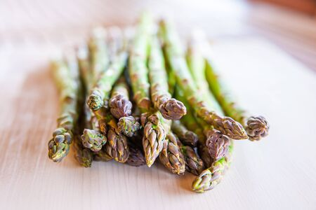 Freshly picked asparagus, on wooden surface