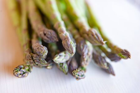 Freshly harvested asparagus, put on a wooden surface