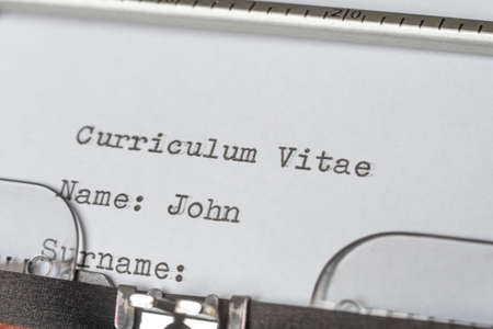 writing a curriculum vitae with the typewriter Stockfoto