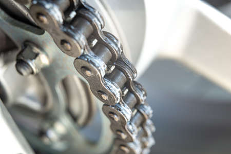 Metal drive chain of a motorcycle, close up shot.