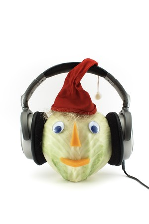 The little man from cabbage with ear-phones and red cap photo