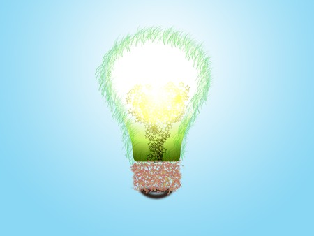 germinating: Lamp from grass on blue background Stock Photo