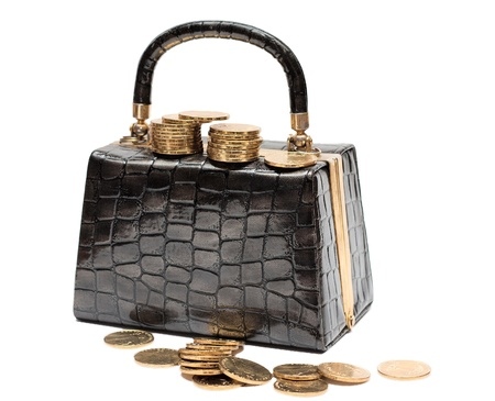 Female leather handbag with coins on a white background