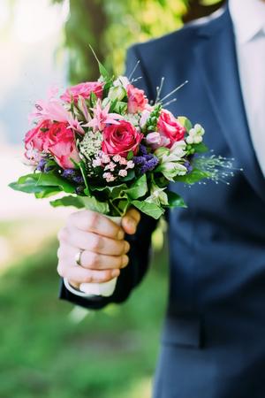 red hand: beautiful wedding bride bouquet, flowers