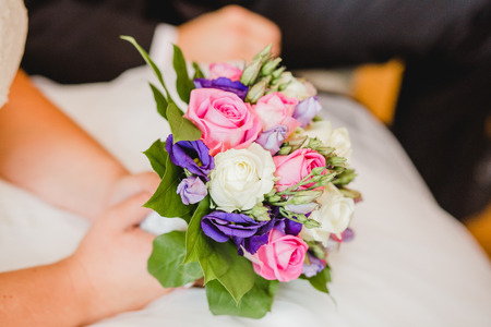 button: wedding flowers bride bouquet and rings