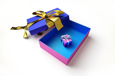 Opened gift box with golden ribbon, with another very small gift inside, on white surface. photo