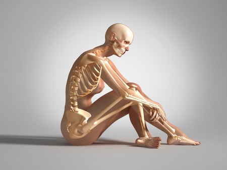 Naked woman sitting on floor, with bone skeleton superimposed. On neutral background photo