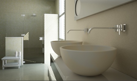 Modern bathroom view with close up on the sinks and a glass shower in the background. photo
