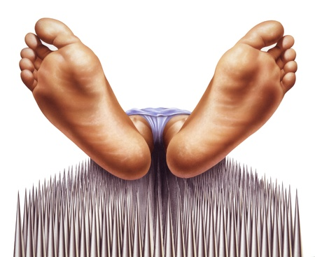 viewed: bed of nails with fakir viewed from feet Stock Photo