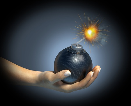 Human hand holding a bomb with burning fuse, on dark background.