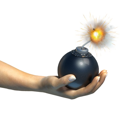 Human hand holding a bomb with burning fuse, on white background. photo