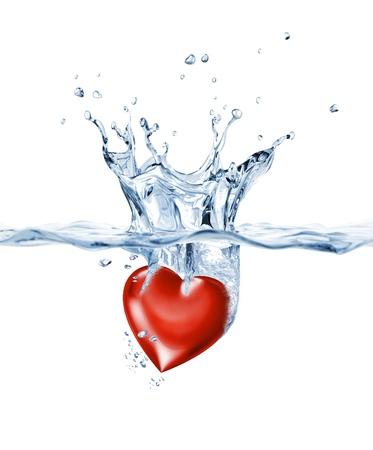 corazones azules: Luminoso coraz�n, cayendo en el agua clara, formando una mancha de la corona.