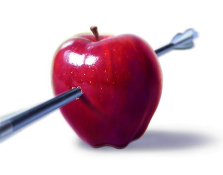 Red apple pierced by an arrow. On white background, with depth of field. Stock Photo