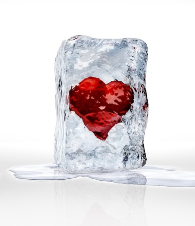 Red heart into an ice brick, over a white surface with some water pool. photo