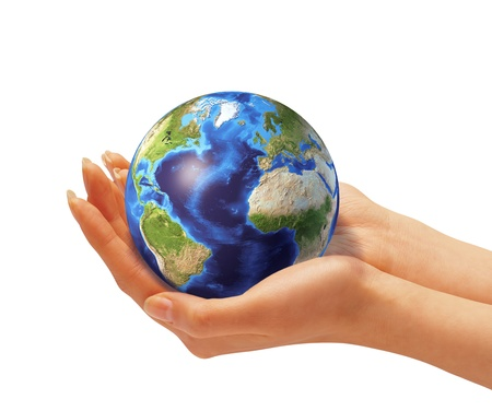 Womans hands holding the earth globe. On white background. Clipping path included photo