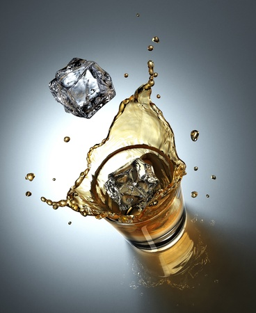 ice cube splashing in a glass full of liquid Reklamní fotografie