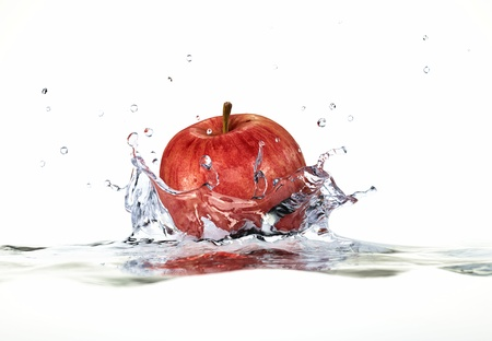 red taste: Red apple splashing into water. close up side view, with depth of field. 3 D digital rendering, on white background. Stock Photo