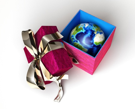 Gift package, with ribboned open cup, with planet Earth inside, viewed from above. Conceptual image. photo