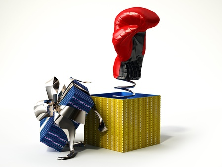 Boxing glove coming out from a gift box, with the cup with silver ribbon, on a side. A kind of fake gift, for joke. photo