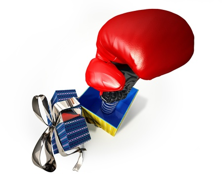 kidding: Aerial view of a Boxing glove coming out from a gift box, with the cup with silver ribbon, on a side. A kind of fake gift, for joke.