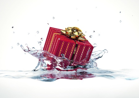 Decorated gift falling into water splashing  On white background Stock Photo - 19893735