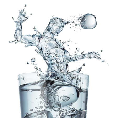 ball on water: Glass of water with a splash shaped as a soccer player jumping and hitting the ball with his head  Close-up view on white background  Concept image  Stock Photo